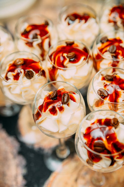 Glass of delicious dessert with whipped cream