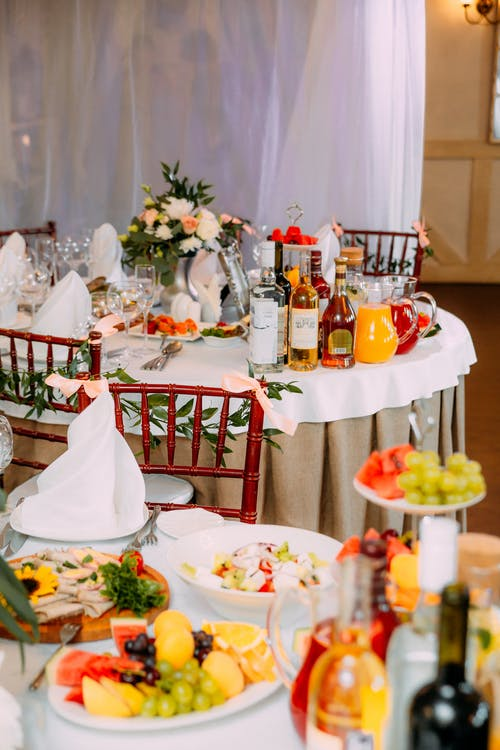 Banquet tables with served food and drinks