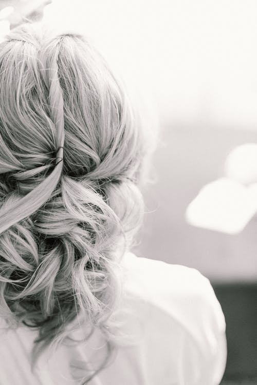 Faceless woman with wavy hairstyle