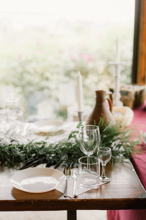 Banquet table with glasses and tableware