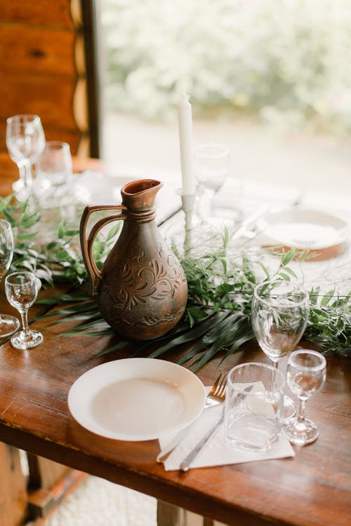 Served table with jug and dishware