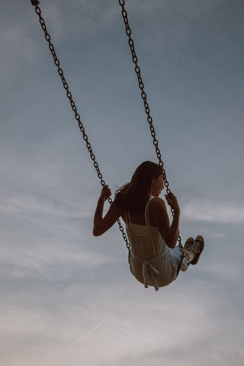 Woman swinging on swing and enjoying ride