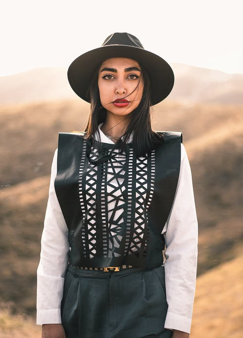 Woman in Black and White Long Sleeve Shirt and Black Hat