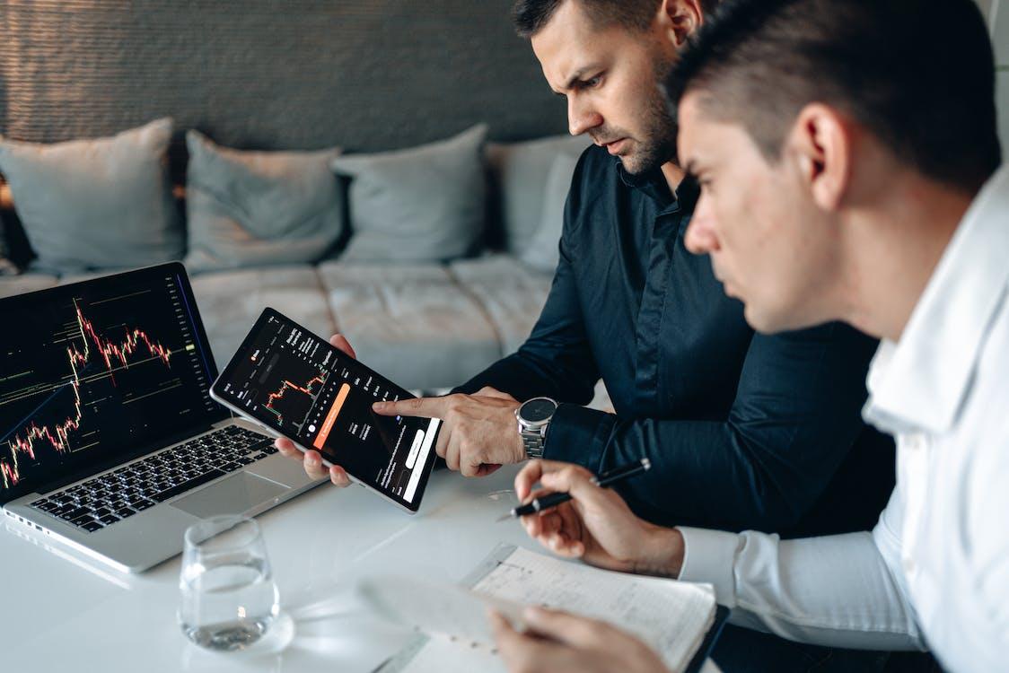 Man in Black Long Sleeve Shirt Holding Black Tablet Computer