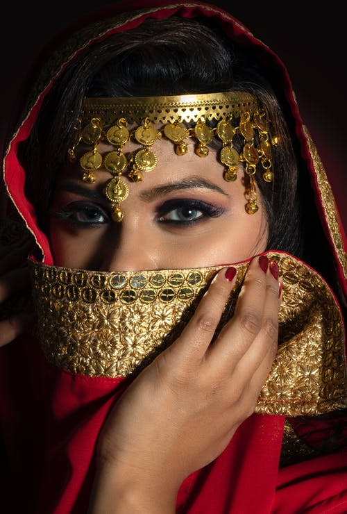 Woman in Gold and Red Hijab