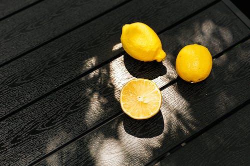 Yellow Lemon Fruit on Gray Wooden Table