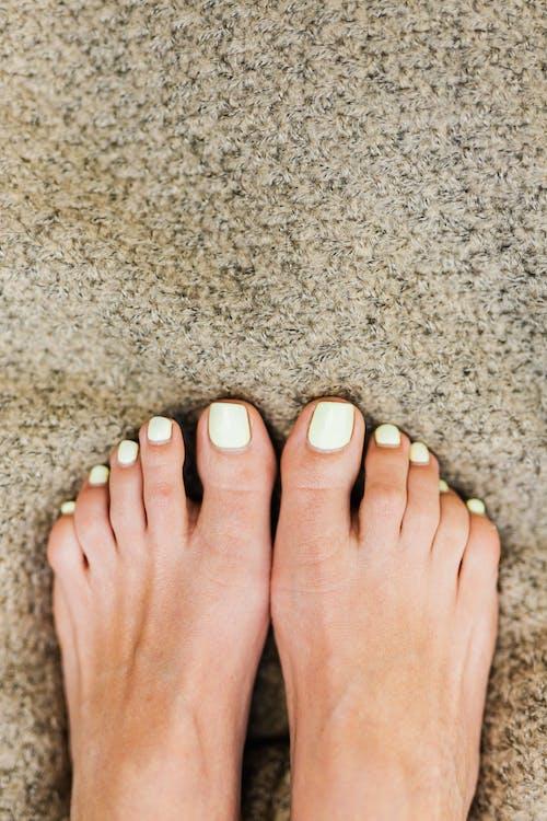 Persons Foot With Brown Nail Polish