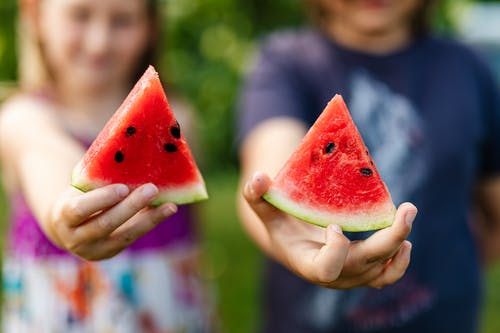 People Holding Watermelon Slices