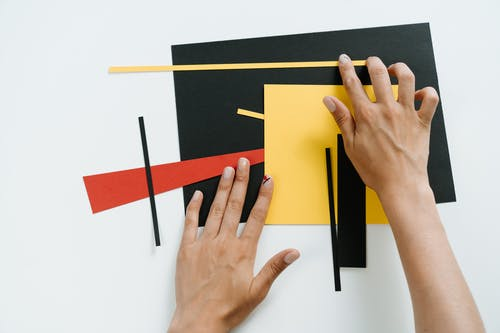 Persons Hand on Yellow Paper