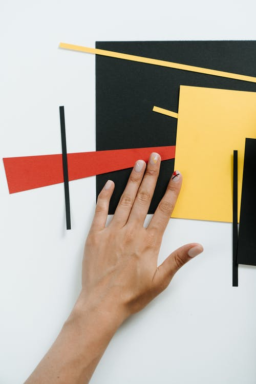 Persons Left Hand on Yellow Paper