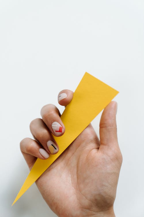 Person Holding Yellow Sticky Note