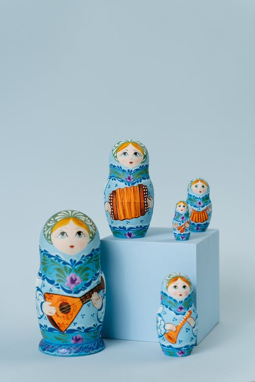 Three Snowman Ceramic Figurines on White Surface