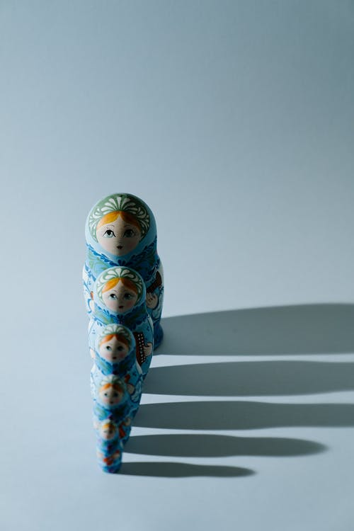 White and Blue Ceramic Figurine