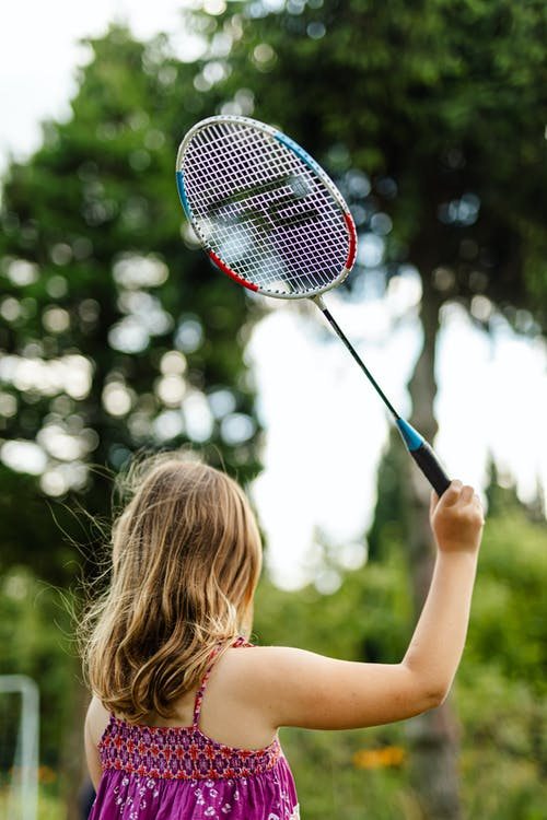 Woman Holding Red and Black Electric Fly Swatter
