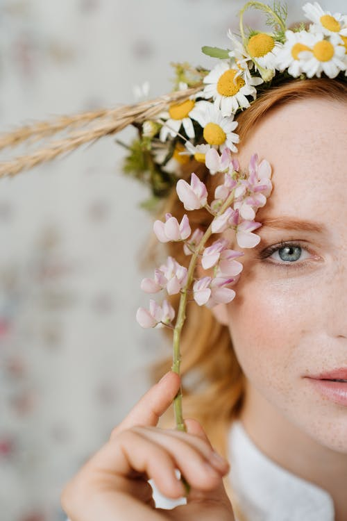 Woman With White Flower on Her Head