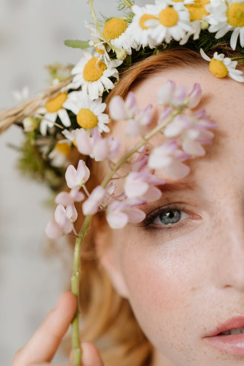 Woman With White and Yellow Flowers on Her Head