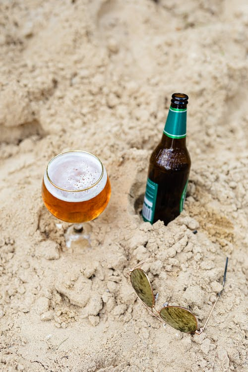 Beer and Sunglasses on the Sand