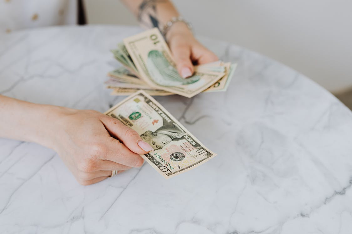 Person Holding US Dollar Bills