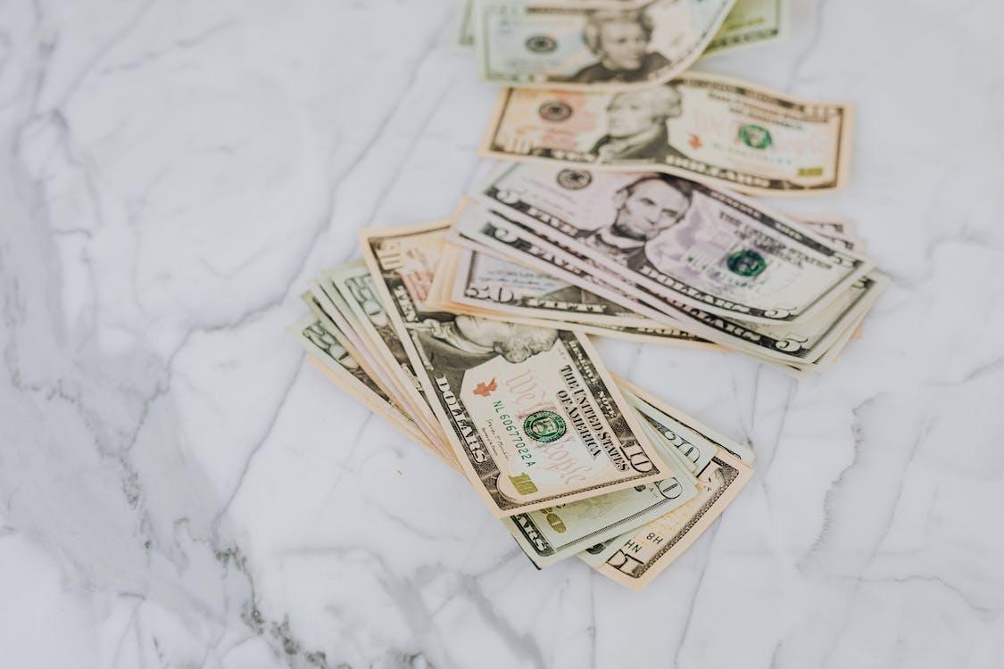Dollar Bills on Marble