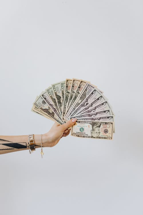Person Holding Fan of Us Dollar Bills