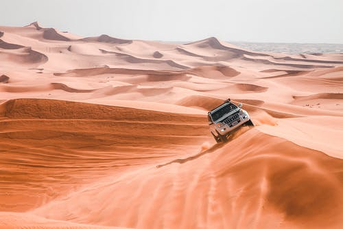 Black and Silver Car on Desert