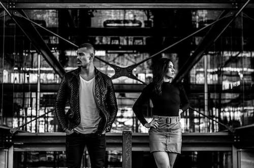 Man and Woman Standing on Bridge