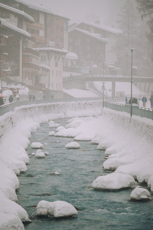 Narrow city canal on cold winter day