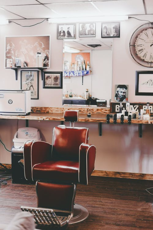 Interior design of modern light hairdressing studio with cozy leather chair and stylish decorative elements