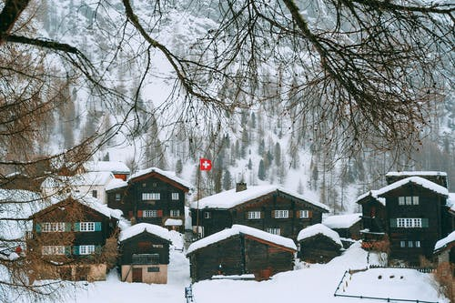 Snowy village houses on hilly terrain