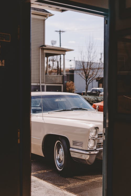 White Car Parked in Front of Store