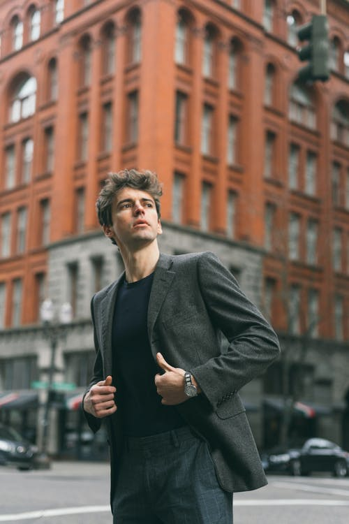 Man in Black Coat Standing Near choize building uk