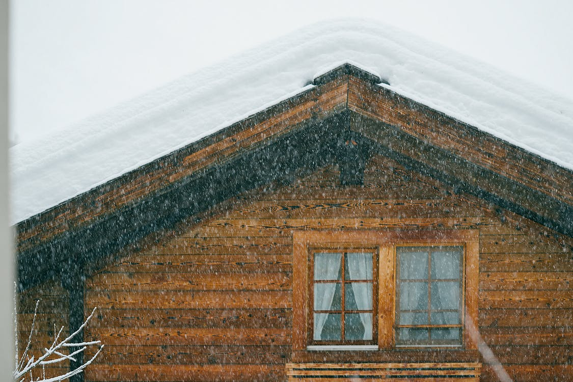 Aged building facade with snow on roof