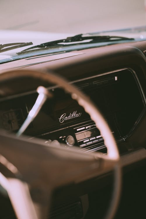 Old fashioned car interior with steering wheel
