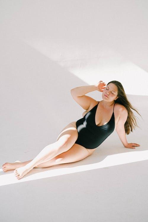 High-Angle Shot of a Beautiful Woman in a Black Bikini