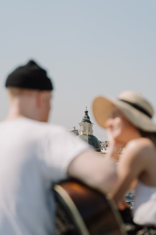 Man in White Shirt and Woman in White Tank Top