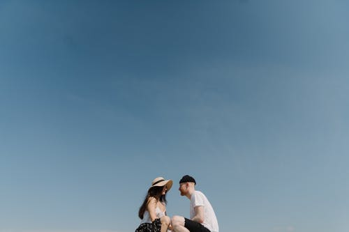Couple Kissing Under Blue Sky