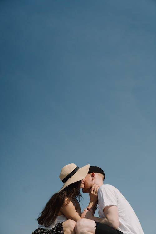 Man in White Shirt Wearing Brown Hat Under Blue Sky