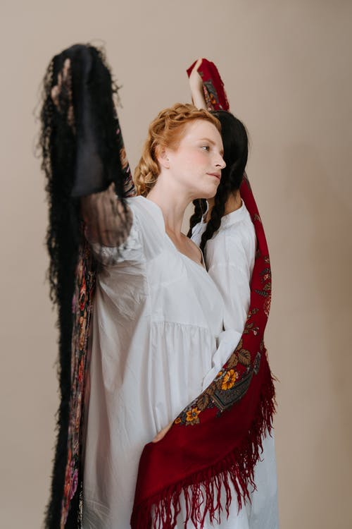 Woman in White Dress Shirt and Red Scarf