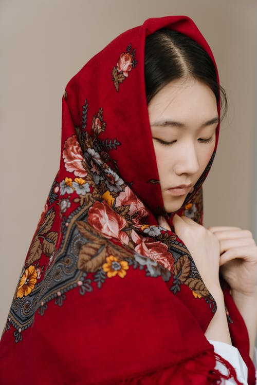 Woman in Red and White Floral Hijab