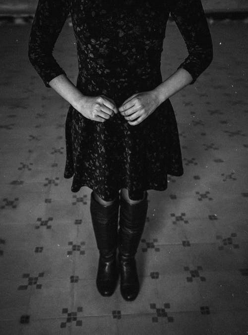 Grayscale Photo of Woman in Black Long Sleeve Dress