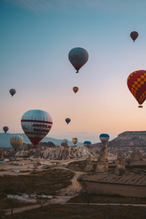 Hot Air Balloons Flying over Brown Rocks