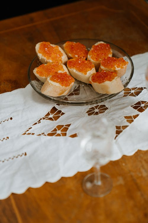 Brown and White Pastries on Clear Glass Bowl