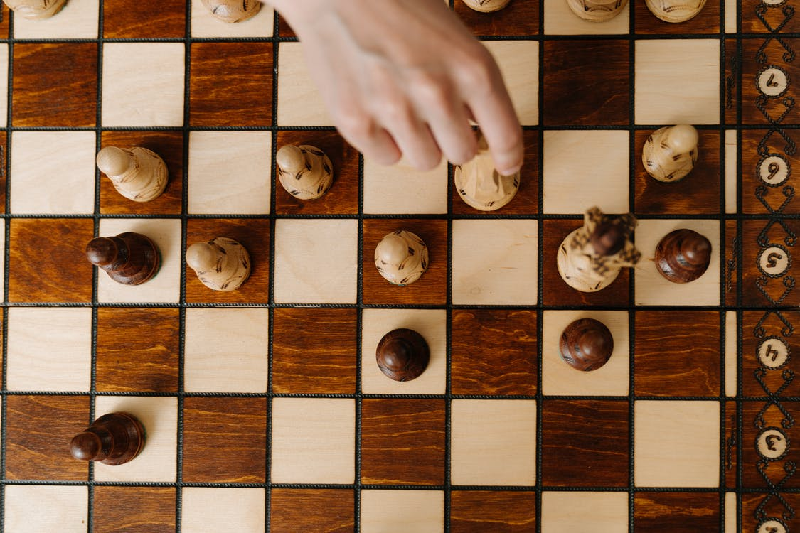 Person Holding Brown Wooden Board