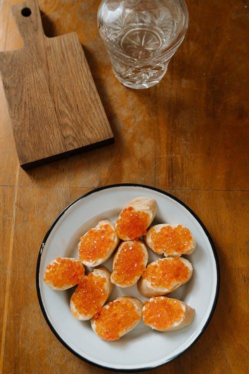 Sliced Orange Fruits on White Ceramic Plate