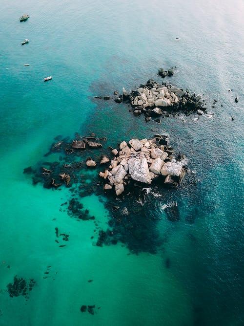 Brown Rocks on Body of Water