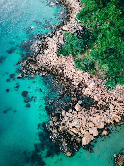 Brown Rocks on Blue Water