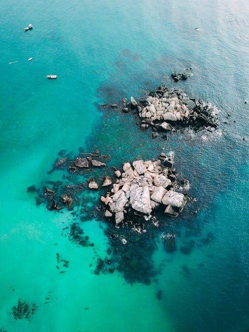 Gray Rocks on Body of Water