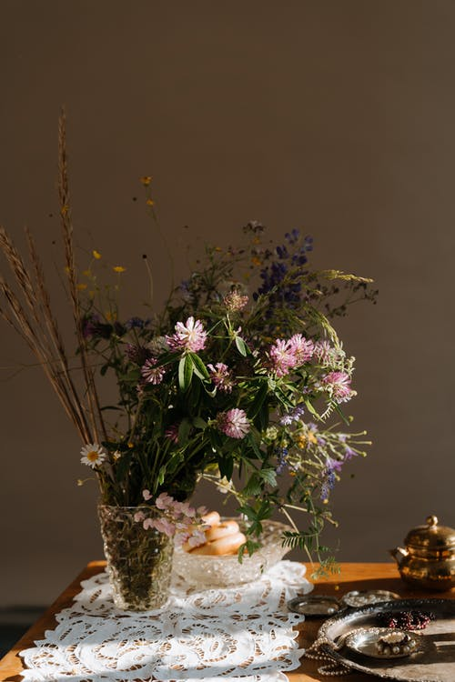 Purple and White Flowers in Brown Wicker Basket