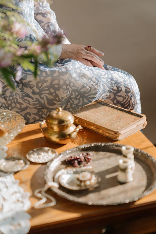 Person Holding Silver Round Tray