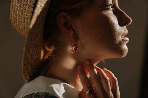 Woman Wearing Gold Diamond Stud Earring